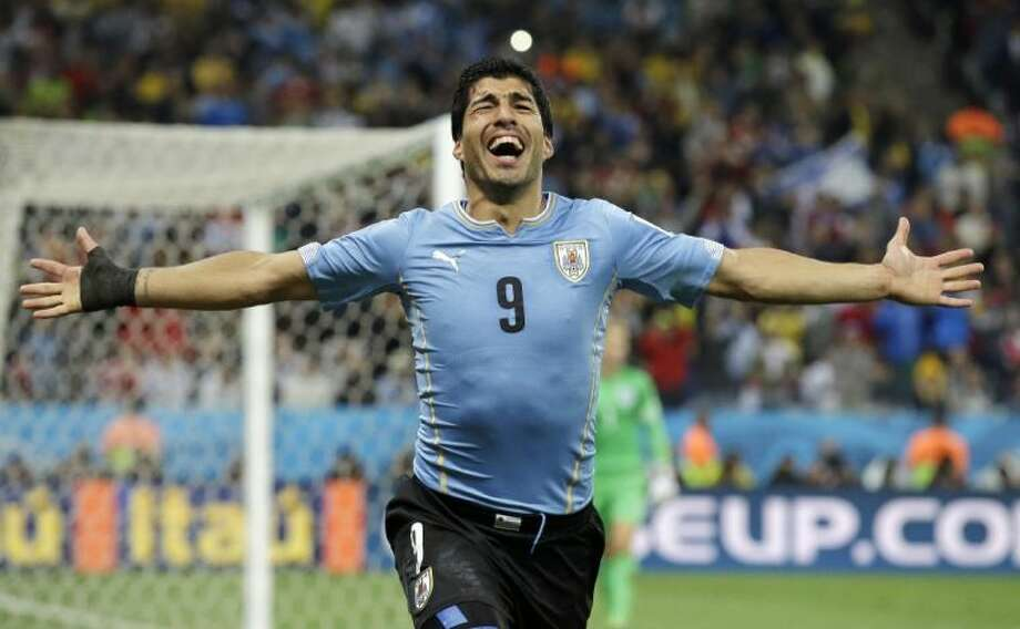 Uruguay's Luis Suarez celebrates after scoring his side's second goal during a Group D World Cup match against England on Thursday at Itaquerao Stadium in Sao Paulo. Photo: Matt Dunham