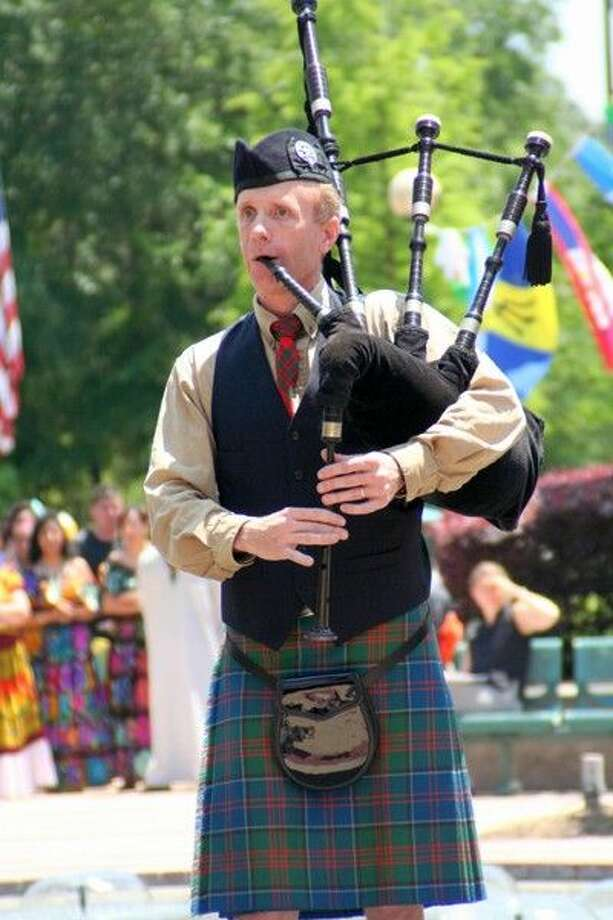 Dr. Craig Livingston plays the bagpipes at an LSC-Montgomery event. Livingston won the Piper Professor award from the Texas non-profit group.