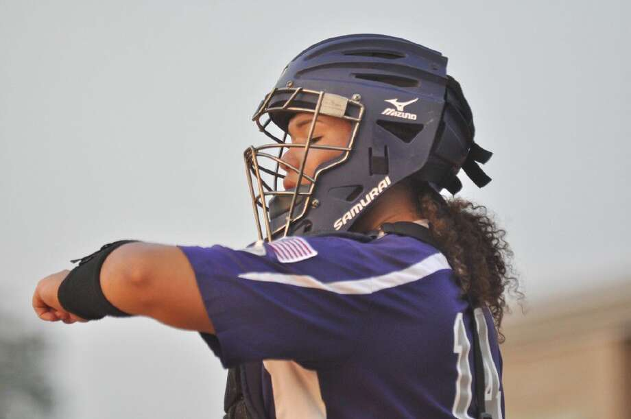 Willis catcher Aubri Ford checks her wristband for the defensive alignment against Magnolia West in Game 1 of the Region III-5A quarterfinals at Willis High School. Photo: Keith MacPherson