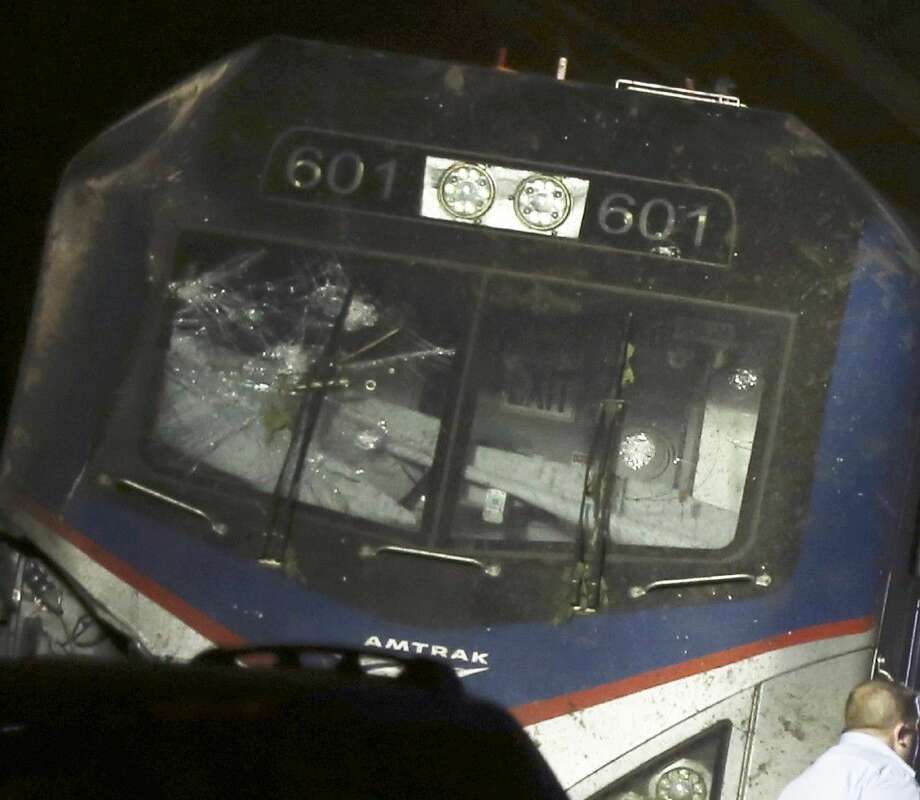 This May 12, 2015 photo shows a broken windshield of an Amtrak train after it derailed in Philadelphia. Photo: Elizabeth Robertson