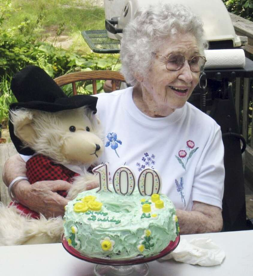 In this Aug. 21, 2009 file photo provided by Scott Barrow, his mother Elizabeth Barrow celebrates her 100th birthday at his home in Dartmouth, Mass.