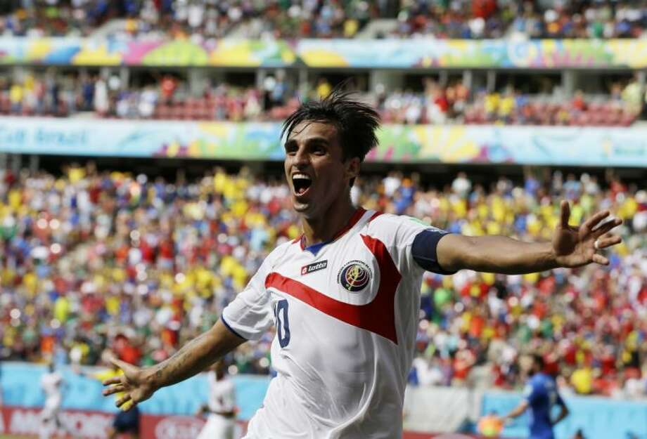 Costa Rica's Bryan Ruiz celebrates after scoring against Italy during a Group D World Cup match on Friday at Arena Pernambuco in Recife, Brazil. Photo: Ricardo Mazalan