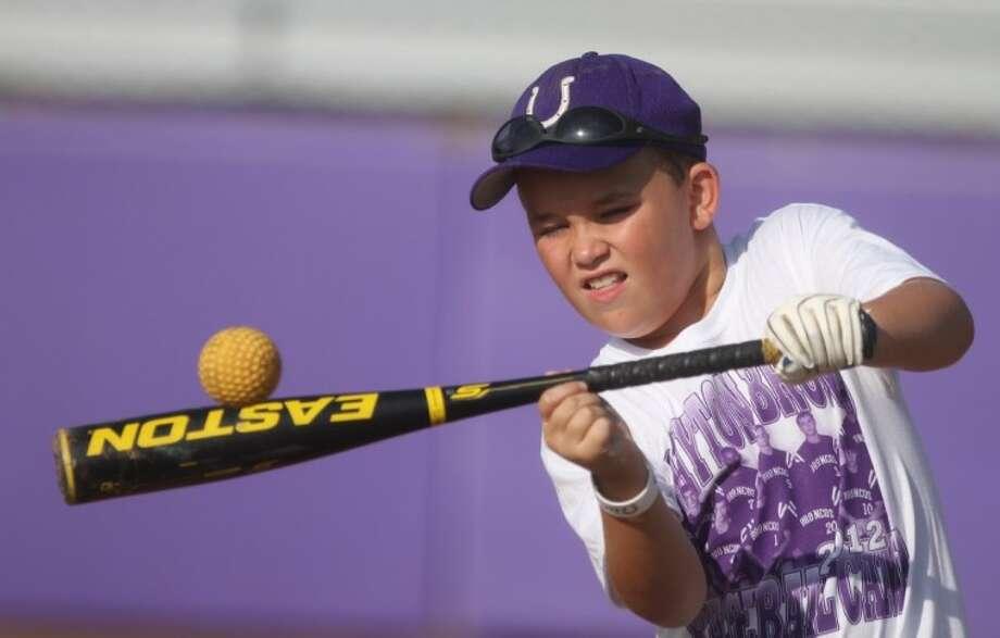 Landon Wood practices his bunting during the Dayton Bronco Baseball Camp at Dayton High School on June 14. Photo: Jason Fochtman