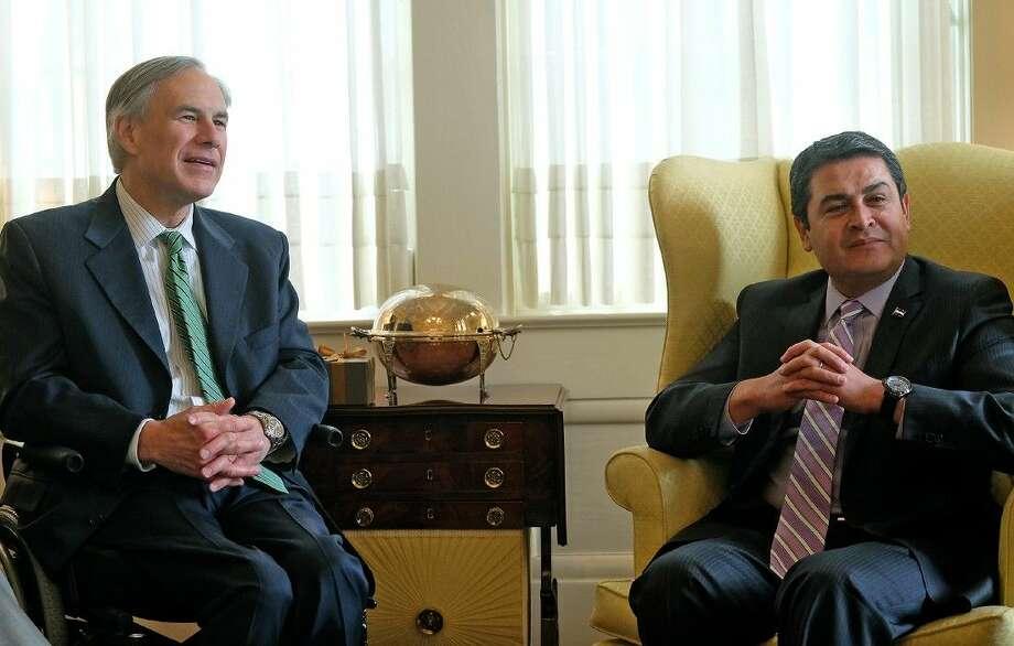 Texas Gov. Greg Abbott and Honduras President Juan Orlando Hernandez, right, visit following a meeting at the governors mansion in Austin on Thursday. Photo: Rodolfo Gonzalez