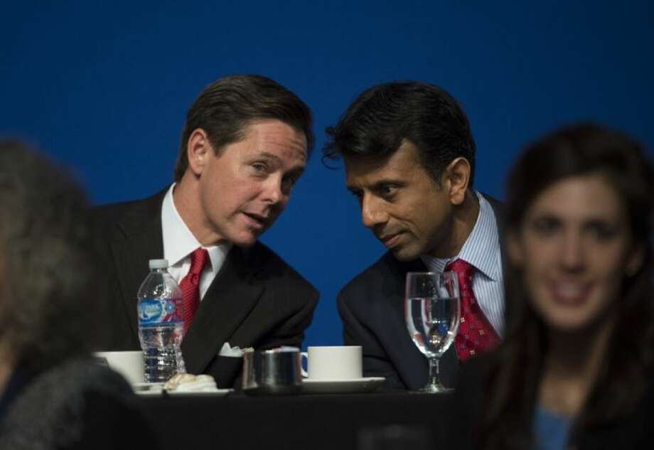 Louisiana Gov. Bobby Jindal, right, talks with Ralph Reed, Chairman of the Faith & Freedom Coalition, before delivering the keynote address during Faith and Freedom Coalition's Road to Majority event in Washington Saturday.