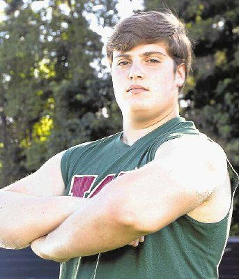 Adrian Piperi III, known as 'Tripp' to his family, coaches and teammates, swept the Class 6A shot put and discus titles last month at the UIL state track and field meet in Austin. Photo: Jason Fochtman