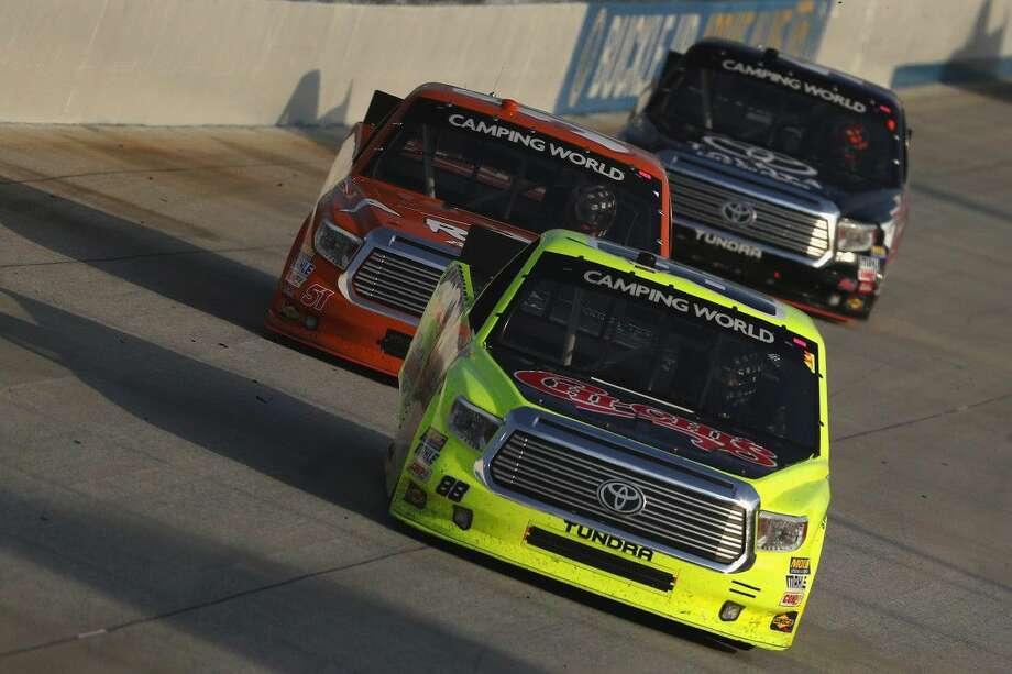 Matt Crafton, front, won the NASCAR Truck Series race at Dover on Friday. Photo: Patrick Smith