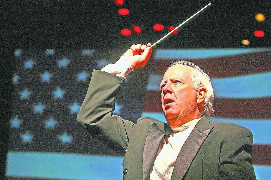 "Dr. Don Hutson, conductor of the Conroe Symphony Orchestra, leads the audience in singing ""The Star-Spangled Banner"" during a previous patriotic concert from the Conroe Symphony Orchestra. This year's patriotic concert that ends the symphony's season is set for this Saturday. Photo: Staff Photo By Karl Anderson"