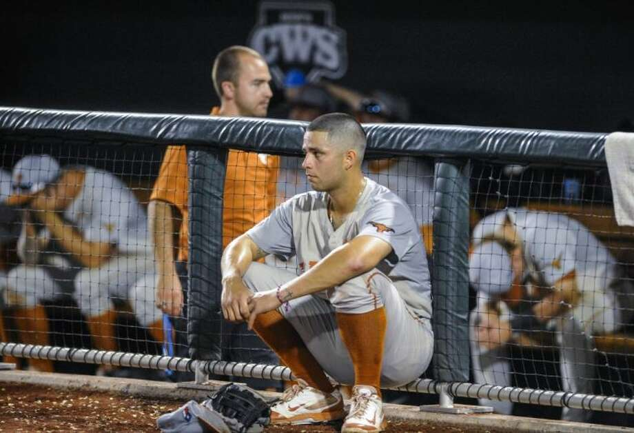 Texas shortstop C.J Hinojosa watches Vanderbilt's celebration outside the Longhorns' dugout after the Commodores rallied for a 4-3 victory in 10 innings on Saturday night. Photo: Eric Francis