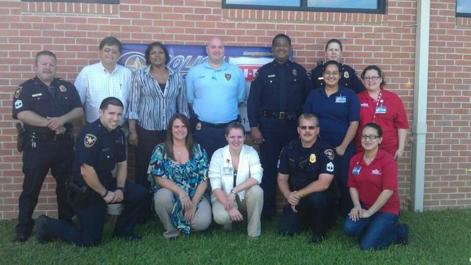 Cleveland police officers recently extended their thanks to various HEB staff members for recognizing them with a breakfast on the anniversary of Sept. 11. Photo: STEPHANIE BUCKNER