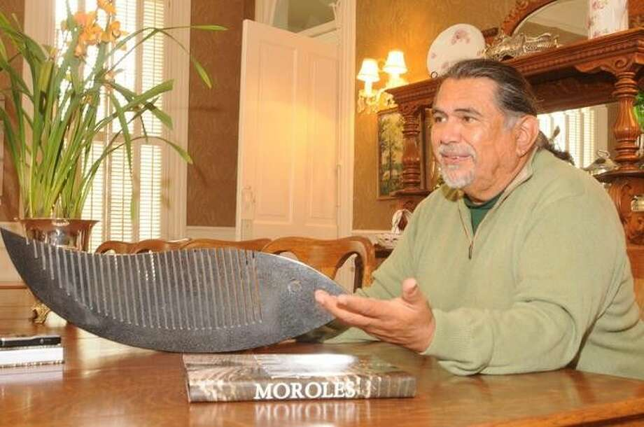 A photo of the renown Texas-born granite sculptor, Jesus Moroles, shown with one of his small sculptures taken while he was sharing his artistic journey at the Wynne Home Arts Center in Huntsville in 2012. Moroles was killed in an auto accident June 15.