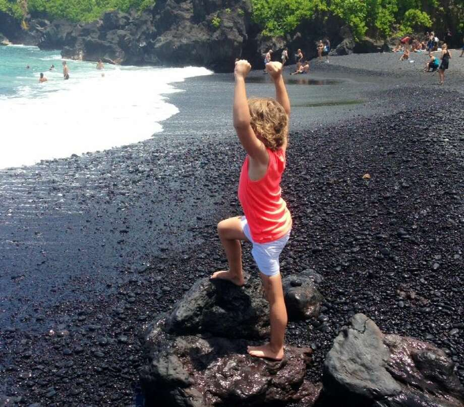 Margaret (Meg) Routh, 8, of The Woodlands, received her wish to go to a black sand beach in Hawaii with her family recently. Meg has malignant neoplasm of long bones of the lower limb.