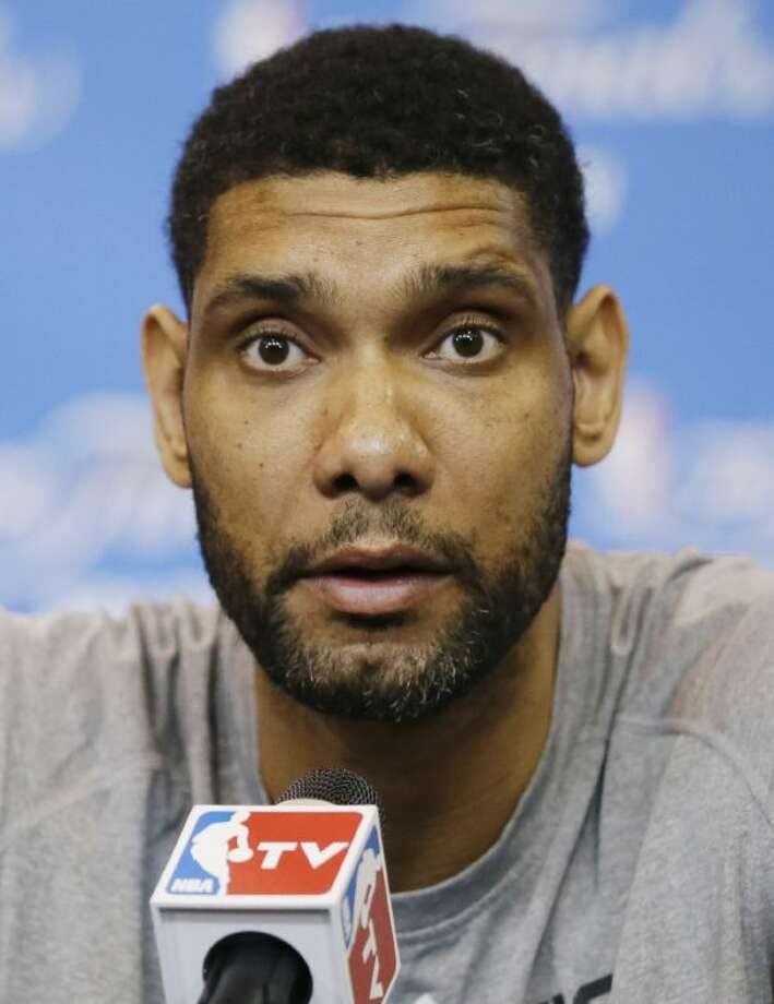 San Antonio Spurs forward Tim Duncan listens to a question during a news conference for the NBA basketball finals on Saturday, June 14, 2014, in San Antonio. The Spurs play Game 5 against the Miami Heat on Sunday. (AP Photo/Tony Gutierrez) Photo: Tony Gutierrez