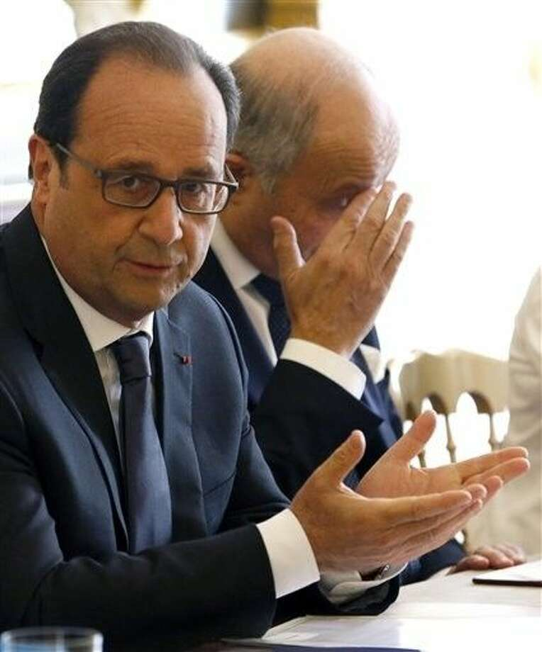 French President Francois Hollande, left, and French Foreign Minister Laurent Fabius chair a meeting at the Elysee Palace in Paris, Thursday. Appearing more irritated and embarrassed than surprised, France's government summoned the U.S. ambassador Wednesday to respond to Wikileaks revelations that the NSA eavesdropped on three successive presidents and other top officials. Photo: Charles Platiau