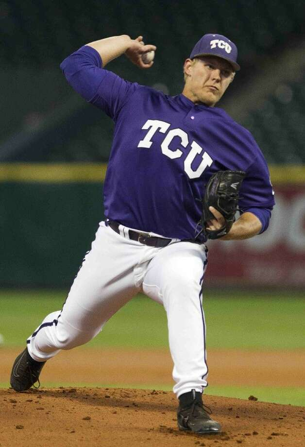 TCU pitcher Luken Baker, a former Oak Ridge player, throws during an NCAA baseball game at the Houston College Classic at Minute Maid Park Saturday. Photo: Jason Fochtman