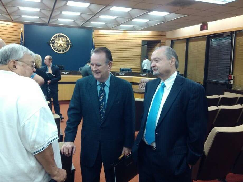 Mayor Johnny Isbell (center) and Roy Mease (right) talk with a constituent after Mease was confirmed by City Council to serve on the Port of Houston Board.