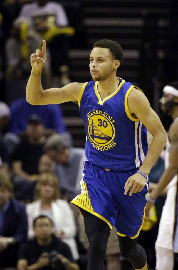 Golden State Warriors guard Stephen Curry gestures against the Memphis Grizzlies, Friday in Memphis, Tenn. Photo: Mark Humphrey