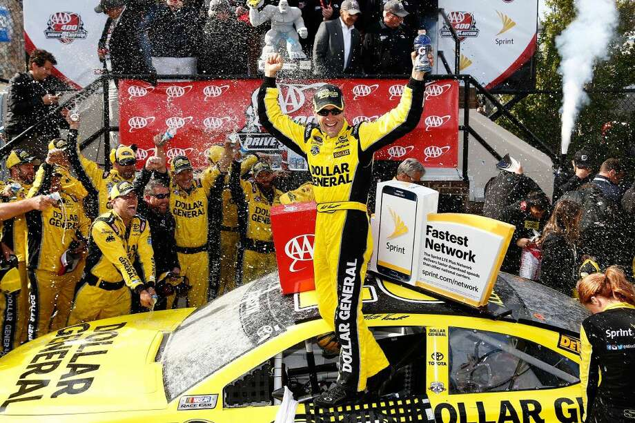 Matt Kenseth, driver of the #20 Dollar General Toyota, celebrates in Victory Lane after winning the NASCAR Sprint Cup Series AAA 400 Drive for Autism at Dover International Speedway on Sunday in Dover, Delaware. Photo: Jeff Zelevansky