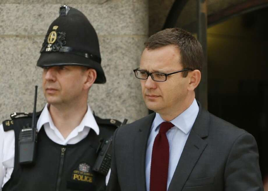 Andy Coulson, former News of the World editor and the former spin doctor of British Prime Minister David Cameron, leaves the Central Criminal Court in London Wednesday.
