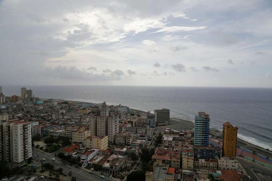 This coastal view of Havana, Cuba shows the United States Interests Section diplomatic mission, the third tall building from the right, on Sunday. Photo: Desmond Boylan