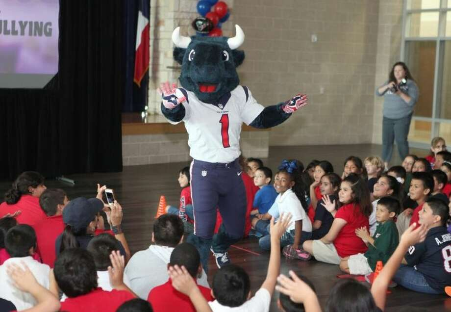 """Houston Texans mascot Toro greets students during the """"Toro Takes the Bull out of Bullying"""" program last week at Pine Shadows Elementary School. Photo: Alan Warren"""