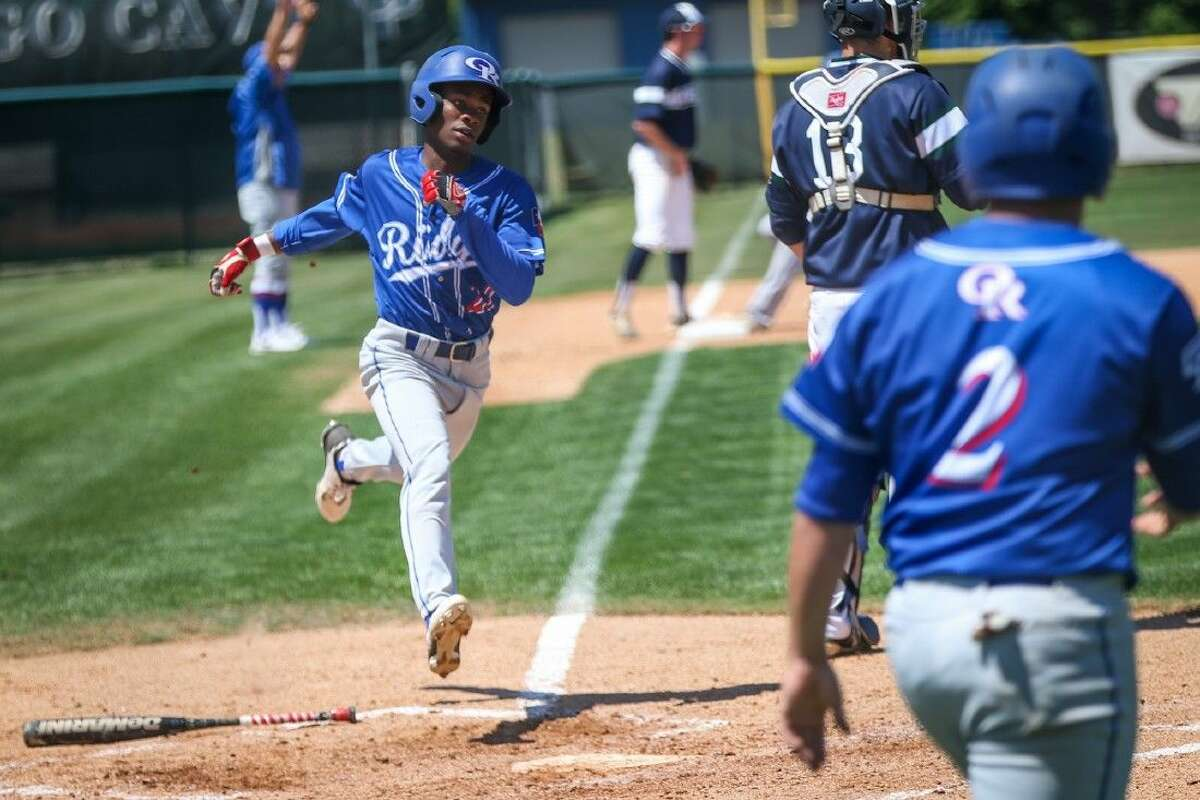 Oak Ridge's Demarco Thomas (22) runs home during the high school baseball game against College Park on Saturday, April 23, 2016, at College Park High School. To view more photos from the game go to HCNPics.com.