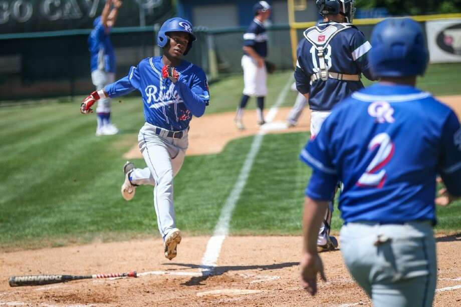 Oak Ridge's Demarco Thomas (22) runs home during the high school baseball game against College Park on Saturday, April 23, 2016, at College Park High School. To view more photos from the game go to HCNPics.com. Photo: Michael Minasi