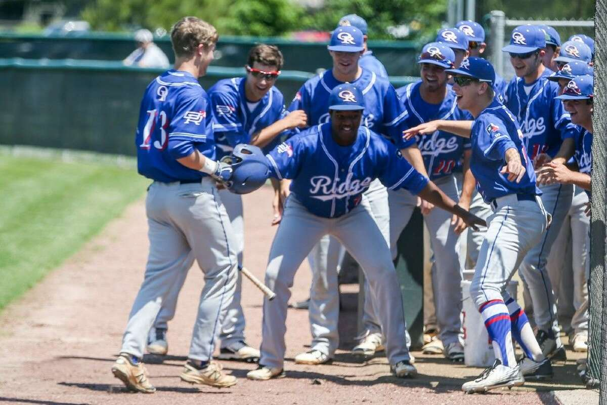 Oak Ridge's Kolton Forsythe (13) celebrates with teammates after scoring a run during the high school baseball game against College Park on Saturday, April 23, 2016, at College Park High School. To view more photos from the game go to HCNPics.com.