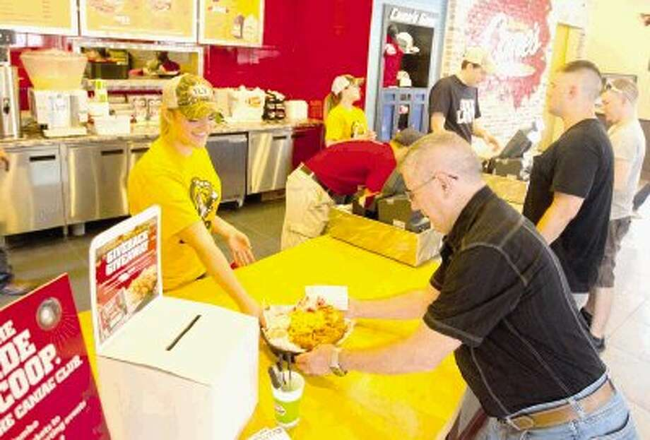 The new Raising Cane's on Texas 105 in Conroe opened with a rush of customers June 5. The first 100 customers received free Raising Cane's for a year, while other received various gift cards and T-shirts. Photo: Jason Fochtman / Conroe Courier / HCN