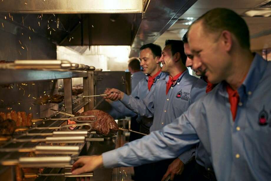 The churrasco chefs of Fogo de Chão Brazilian Steakhouse.