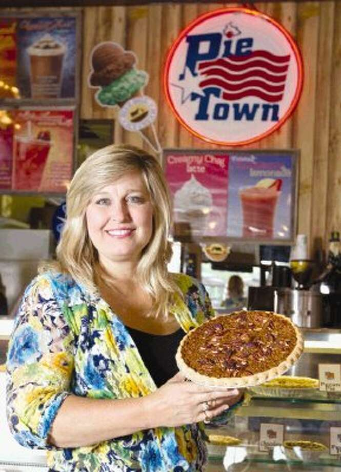 Debra Loggins, co-owner of Pie Town, poses for a portrait in her cafe in Shenandoah Tuesday. In addition to various other food and drink items, the cafe offers 35 different types of pies year around. Photo: Jason Fochtman / Conroe Courier / HCN