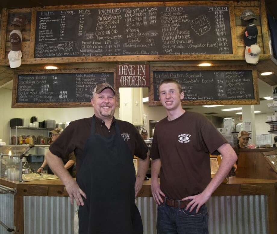 Darin McKenzie, left, co-founder of McKenzie's Barbeque and Burgers & Fries with his son Colin, 18, a new generation joining the family business. With locations in Montgomery, Conroe and Huntsville, the long-time establishment is a staple for barbecue in the area.