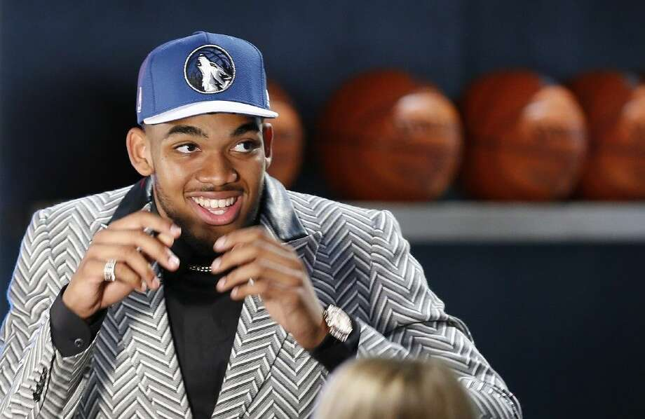 Karl-Anthony Towns reacts after being selected first overall by the Minnesota Timberwolves during the NBA basketball draft. Photo: Kathy Willens