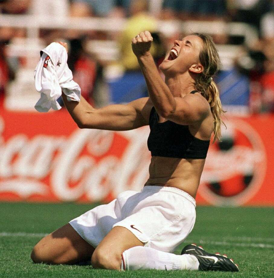 In this July 10, 1999, file photo, the United States' Brandi Chastain celebrates by taking off her jersey after kicking in the game-winning penalty shootout goal against China in the FIFA Women's World Cup Final at the Rose Bowl in Pasadena, Calif. The last time the United States played China was at the World Cup final in 1999. The two countries play on Friday in the quarterfinals of the FIFA Women's World Cup in Canada. Photo: Lacy Atkins