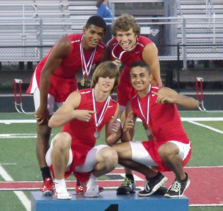 The relay team of Zach McComber, Huestis McAnally, Jay Bradford and Kagan Angers poses on the medal stand at the District 22-3A Track and Field Championships in Huffman. Photo: Submitted Photo