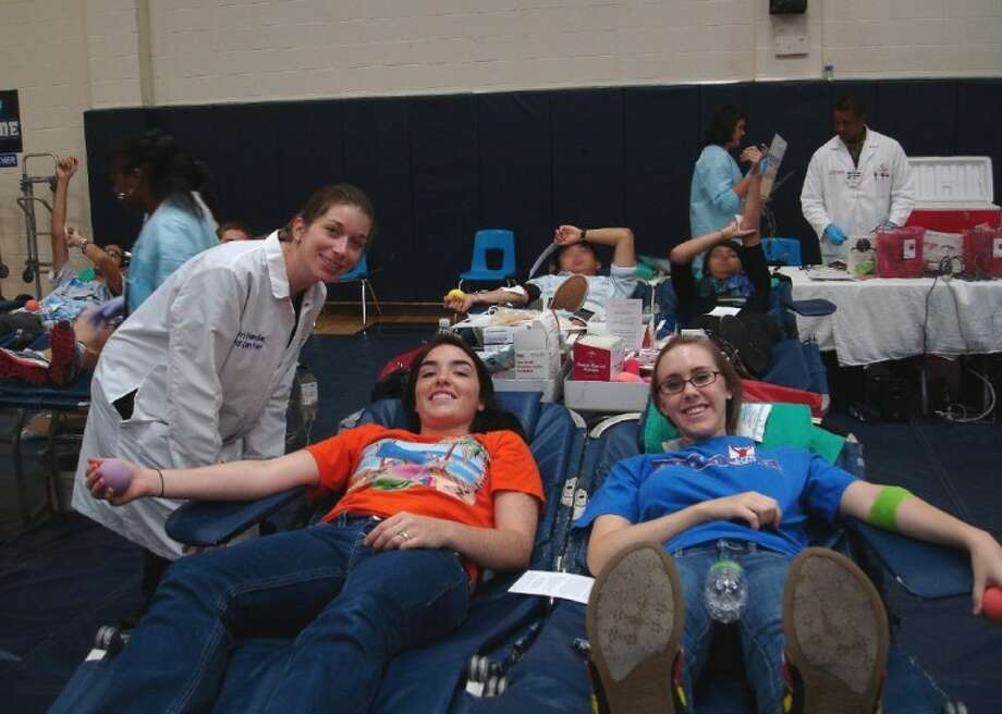 Shown (from left to right) are: Sheri Thide, St. Luke's Donor Phlebotomist, and Clements seniors Jessica Reagan and Tori Reynolds.