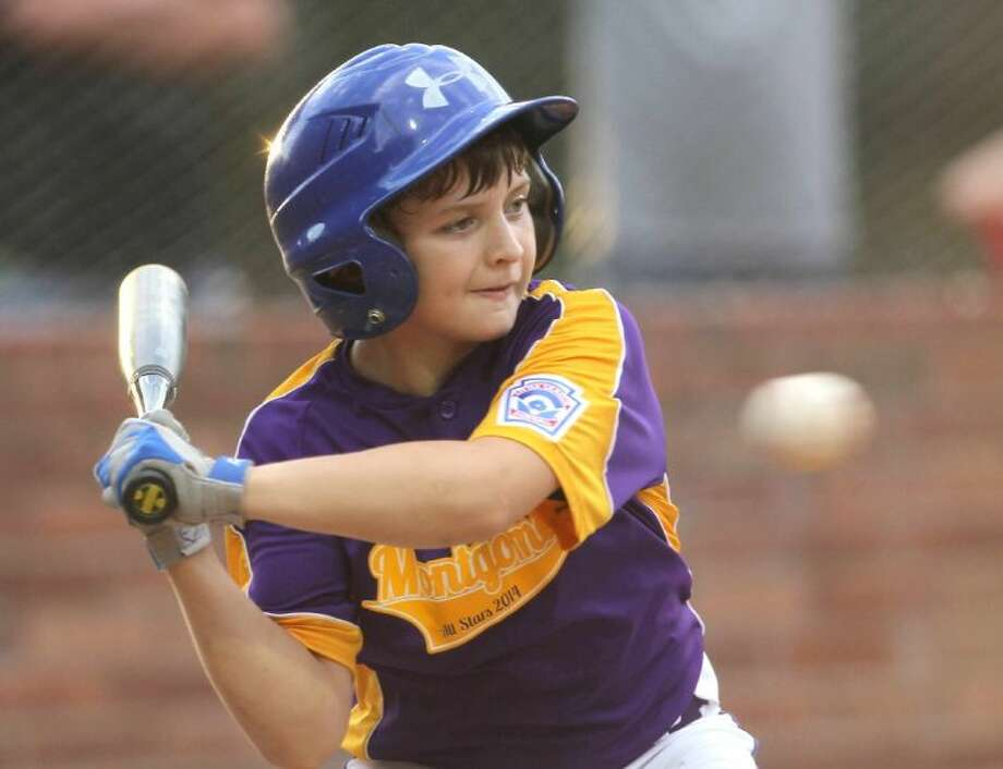 The Montgomery All-Stars' Brandon Nicholson fields a ball during the second round of the District 28 10-11 year old tournament at ORWALL baseball fields Thursday. To view or purchase this photo and others like it, visit HCNpics.com. Photo: Jason Fochtman