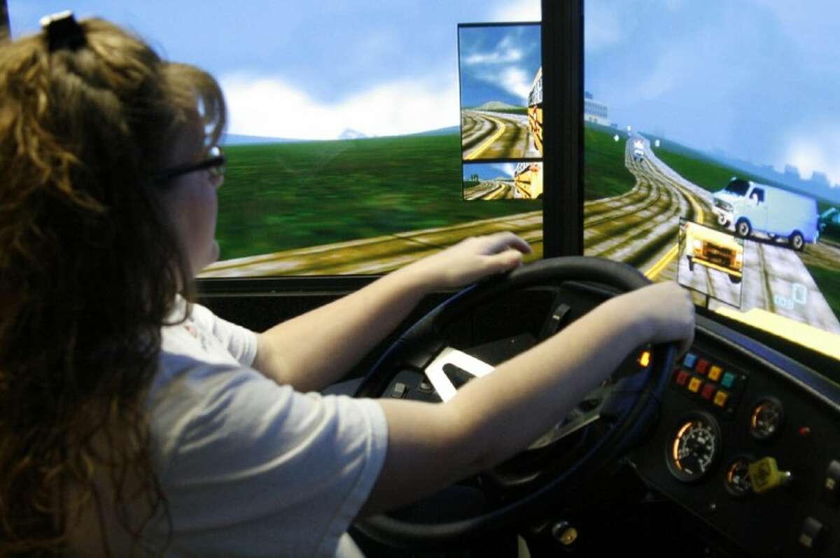 A New Caney ISD bus driver works with the Region VI simulator to practice safely driving a bus during one of their training days Jan. 19.