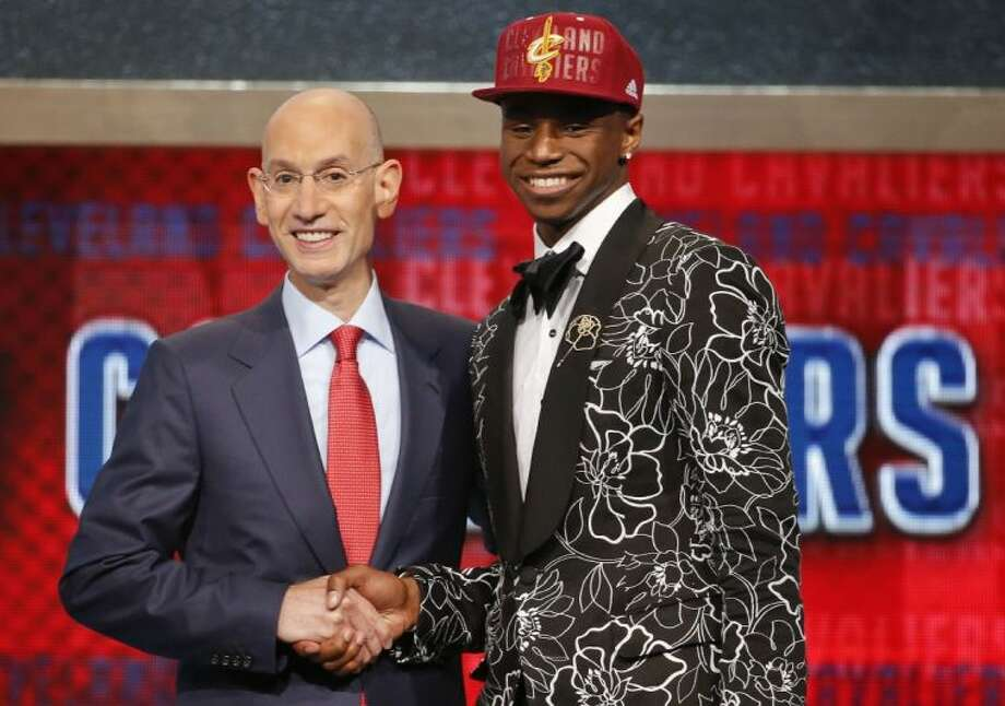 NBA Commissioner Adam Silver, left, congratulates Andrew Wiggins of Kansas who was selected by the Cleveland Cavaliers as the number one pick in the 2014 NBA draft Thursday in New York. Photo: Jason DeCrow