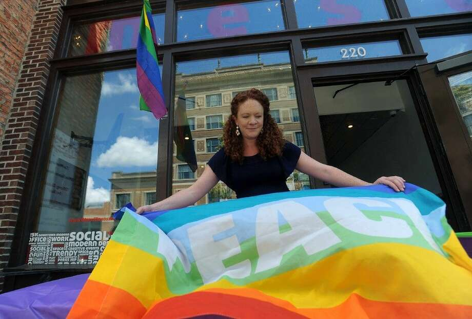 Heather Smith with the American Civil Liberties Union decorates in front of Meso for a pop up celebration in honor of the Supreme Court's rule in favor of same sex marriage nationwide on Friday, in downtown Sioux Falls, S.D. Photo: Jay Pickthorn