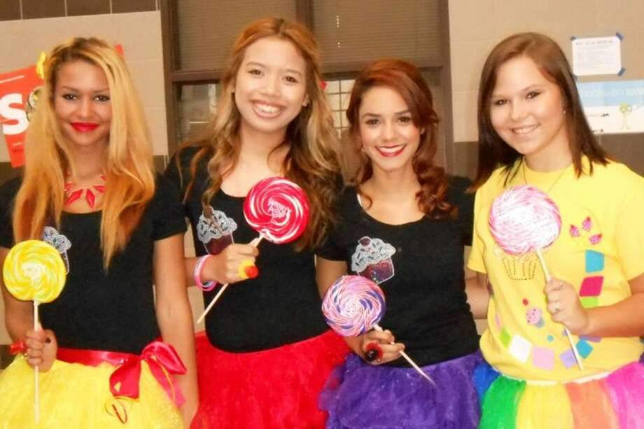 "Senior students Shawntavia Davis, Victoria Yos, Celenia Molitar and Caitlin Zymowski dress up as lollipop girls for the ""Candy Land"" pep rally for Oak Ridge High School."