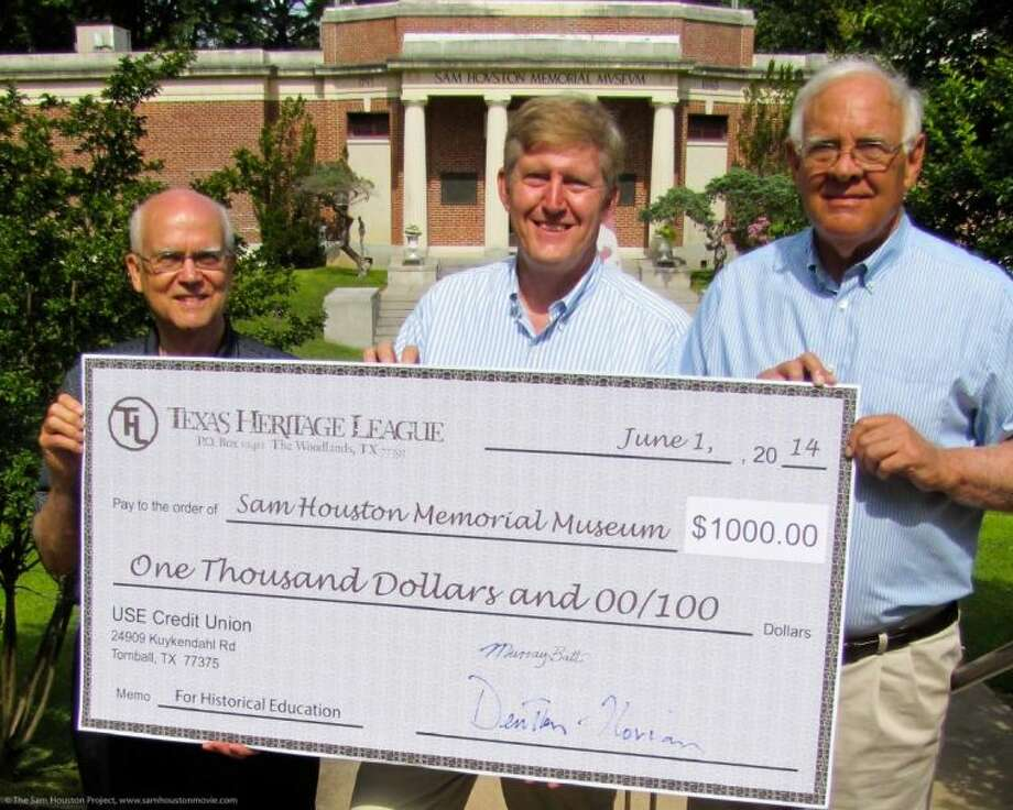 """The Texas Heritage League presented a check to the Sam Houston Memorial Museum in Huntsville June 20. The Texas Heritage League is a 501(c)3 organization that supports educational projects about the history and heritage of Texas. The donation came from proceeds from the sale of the documentary """"Sam Houston."""" Pictured from left: Murray Batt, treasurer of the Texas Heritage League, Denton Florian, president, and Mac Woodward, director of the Sam Houston Memorial Museum and mayor of Huntsville. Photo: The Sam Houston Project"""