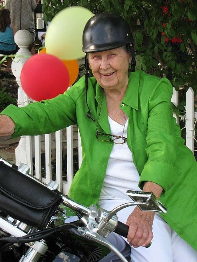 """Lura """"Mama Lu"""" Williams on the seat of a motorcycle during her 90th birthday in 2009."""