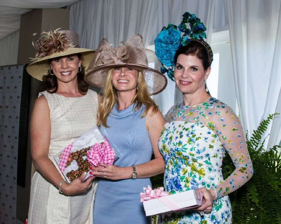 Pictured from left are 2014 Tea on the Lawn sponsorship chair Stephanie Milstead, and event co-chairs Ally Seder and Shirelle Chimenti.