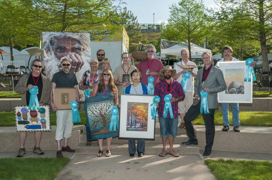 On the final day of the festival, the winners of the Best of Show and Featured Artist honors were revealed. The artists chosen and their mediums are: front row, from left: Terrell Powell, Mixed Media 2D, Featured Artist 2017; Jay Long, Best of Show, Mixed Media 2D; Kimberly Merck-Moore, Best of Show, Mixed Media 3D; Jaeryon Ha, Best of Show, Drawing; Bryon Sutherland, Best of Show, Glass; Alex Horst, Best of Show, Jewelry; Middle Row, from left: Jason and Danielle Napier, Best of Show, Sculpture; Peter Karner, Best of Show, Clayworks; Stephen Kostyshyn, Best of Show, Fiber; Jay McDougall, Best of Show, Wood; Gregory Strachov, Best of Show, Painting; Back Row, from left: Greg Davis, Best of Show, Photography.