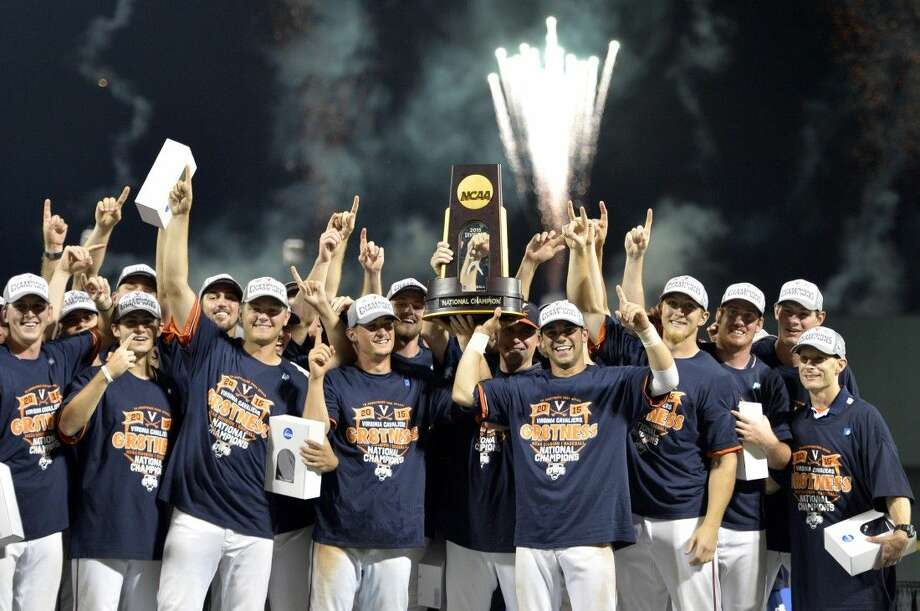 Virginia players celebrate after a 4-2 victory over Vanderbilt on Wednesday night brought the Cavaliers their first College World Series title in school history. Photo: Ted Kirk