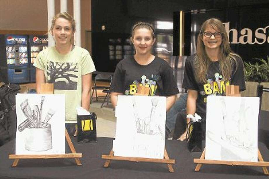 Pictured are finalists from the 2012 Fast Draw Contest. Pictured, from left, is second-place honoree Alexis Hunsucker, first-place winner Paxton Grimm and third-place recipient Ava Bramlett. / @WireImgId=2642754