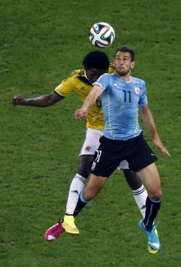 Colombia's Carlos Sanchez Moreno, left, and Uruguay's Christian Stuani go for a header during a round of 16 match at the World Cup. Colombia won 2-0. Photo: Fabrizio Bensch