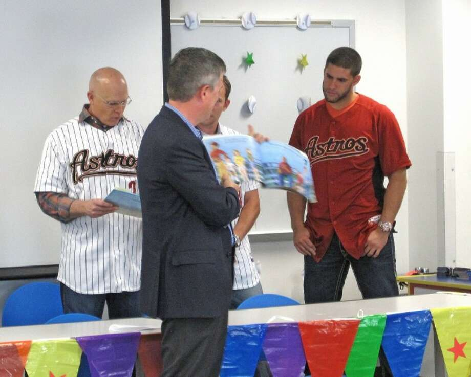 Astros General Manager Jeff Luhnow reads to more than 60 children and 50 adults at storytime,with Astros players Brad Mills, Jed Lowrie and J.D. Martinez, before signing autographs on a recent visit to Lone Star College-CyFair.
