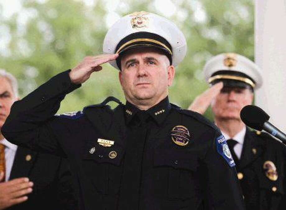 Chief Philip Dupuis salutes during the annual Police Officers Memorial Ceremony at Heritage Place Park on Thursday. The ceremony coincided with National Police Week where communities across the country remember those officers who have lost their lives in service to their communities.